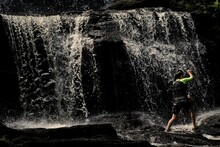 Boy In Front Of Waterfall