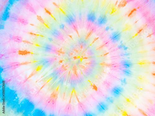 Rainbow tie-dye wallpaper. Hippie spiral tie bye background. Colorful burst.