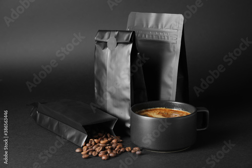Obraz Blank coffee bags and cup on dark background - fototapety do salonu