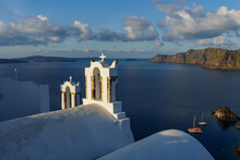Arch With A Bell, White Church In Oia, Santorini, Greece.