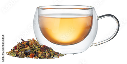 Fotografie, Obraz Glass cup of tea with dry tea leaves isolated on white