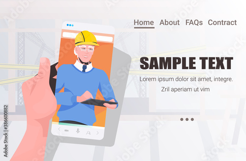 Obraz male engineer on smartphone screen discussing during video call self isolation online communication concept construction site master in helmet horizontal copy space portrait vector illustration - fototapety do salonu