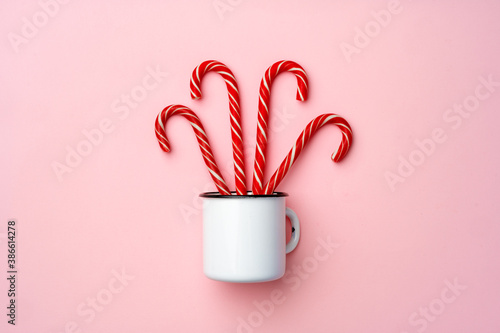 Candy canes on pink background top view Fototapet
