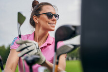 Pleased Golf Player In Sunglasses Looking Away