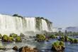 The stunning Iguazu Falls in a beautiful day with blue sky. Foz do Iguaçu, Brazil.