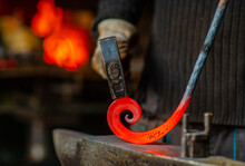 The Blacksmith Twists The Spiral With A Sledgehammer, Placing A Red-hot Iron Blank On The Anvil. Work In The Forge