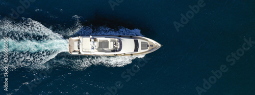 Obraz Aerial drone ultra wide photo of luxury yacht with wooden deck cruising in Aegean deep blue sea - fototapety do salonu