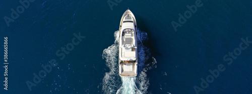 Obraz Aerial drone ultra wide photo of luxury yacht with wooden deck cruising in Aegean deep blue sea - fototapety do salonu