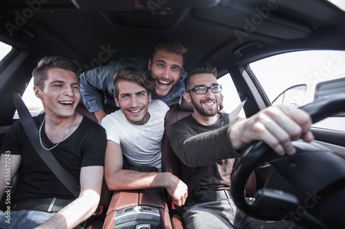 Slika na platnu close up.funny friends travel in the car.
