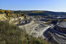 An Old Stone Quarry In A Large Ravine Among The Ural Forests In Autumn Decoration. In The Foothills Of The Western Urals, Golden Autumn.
