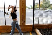 Young Girl Throws An Axe At A Target In An Axe Throwing Range