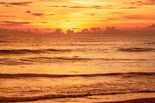 View Of Beautiful Glorious Golden Sunset And Golden Hour Above The Sea In Evening