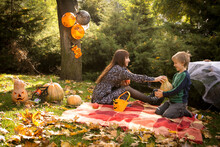 Halloween. Happy Family - Mom And Son At A Halloween Picnic. Warm Autumn October Day.
