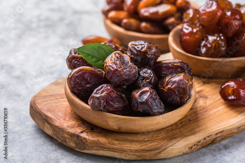 Tela Dates or dattes palm fruit in wooden bowl is snack healthy.