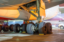 Group Of Main Landing Gear Of A Wide-body Aircraft Under The Wing And Fuselage.