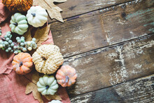 Wooden Fall Background With Pumpkins And Leaves