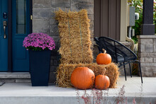 Pumpkin And Pumpkins On Hay Make A Beautiful Autumn Display.