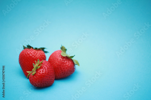 strawberries on a blue background