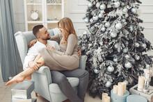 Couple Near Christmas Tree. La...