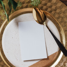Gold Place Setting With Empty Menu, Gold Spoon And Natural Branches