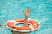 Lifebuoy With Hands In The Wat...