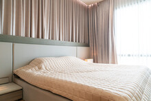 Bed With Bedspread In Bedroom