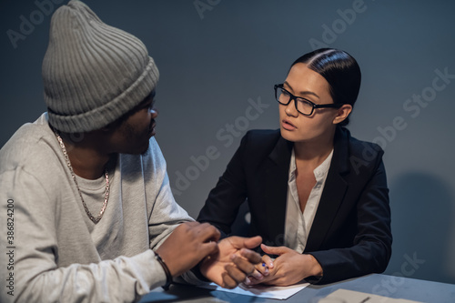 In the interrogation room, a suspect in a drug distribution and possession case consults with a public defender Wallpaper Mural