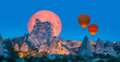 "Leinwandbild Motiv Hot air balloon flying over Uchisar castle with full moon ""Elements of this image furnished by NASA """