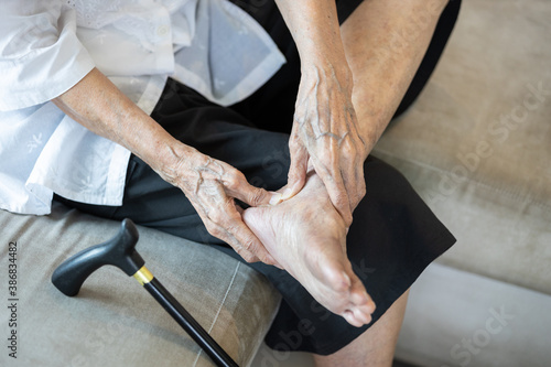 Old elderly with foot injuries,heel pain or ankle diseases,asian senior woman su Canvas Print