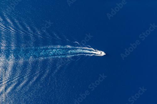 Obraz Motorboat and white wake on rippled sea background - fototapety do salonu