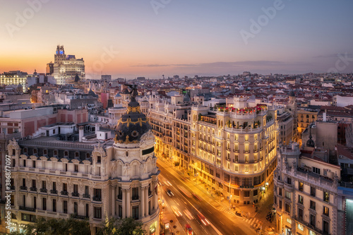 Obraz Panoramic aerial view of historic buildings on Gran Via, the famous shopping street in Madrid, capital and largest city in Spain, Europe. - fototapety do salonu
