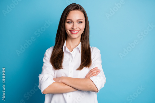Photo of attractive business lady arms crossed good mood wear white shirt isolated blue color background - 386884808