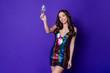 Leinwandbild Motiv Photo of positive charming girl raise glass champagne wear glossy skirt isolated shine purple color background