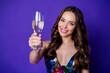 Leinwandbild Motiv Photo of sweet lovely girl raise champagne glass wear glossy skirt isolated bright violet color background