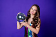 Leinwandbild Motiv Photo of attractive lady hold large big glowing disco ball wear glossy sequins dress isolated purple color background
