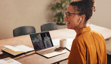Business Woman Laughing During A Video Call With Team