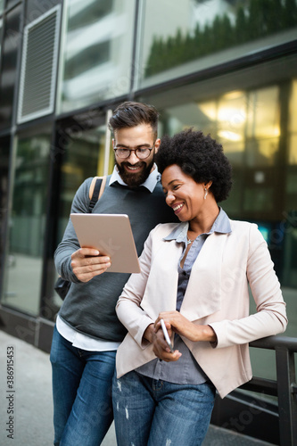 Fototapeta Couple, business, technology concept. Businessman with tablet and woman with smartphone talking obraz na płótnie