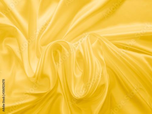 Obraz na plátně Beautiful smooth elegant wavy light yellow satin silk luxury cloth fabric texture, abstract background design