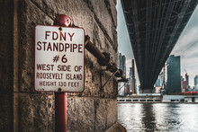 FDNY Sign With Red Standpipe West Side Of Roosevelt Island Under The Bridge In Manhattan