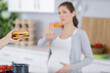 pregnant woman with belly refused to eat a burger