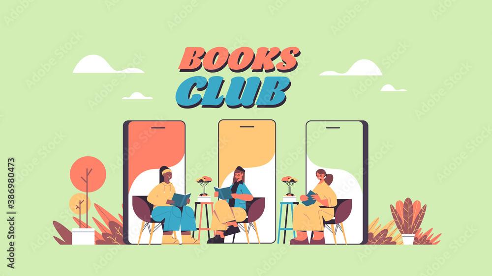 Fototapeta mix race women on smartphone screens reading books during video call self isolation book club concept horizontal full length vector illustration