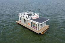 A Houseboat On A Lake In The City, A Place Of Snouth And Entertainment.