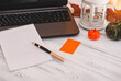 laptop, pen, Notepad, pumpkins, candle on a white wooden table, autumn still life