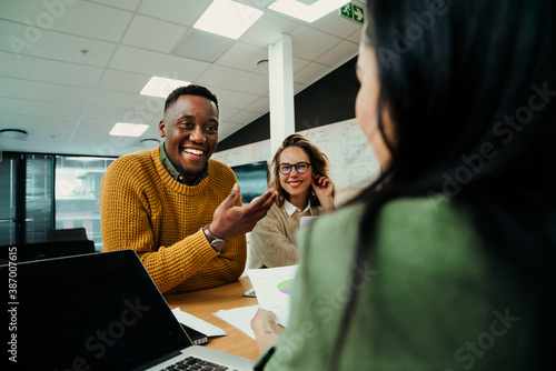 Fotografia Businessman laughing at friends during lunch break before meeting with clients