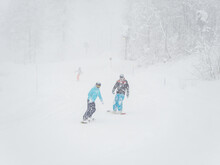 Snowboarders Roll On The Track...