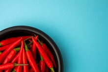 Hot Red Chili, On Blue Background