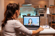 Professional photographer working on photos from home office during night time. Content creator doing portrait retouching using performance laptop, artist, occupation, screen, graphic