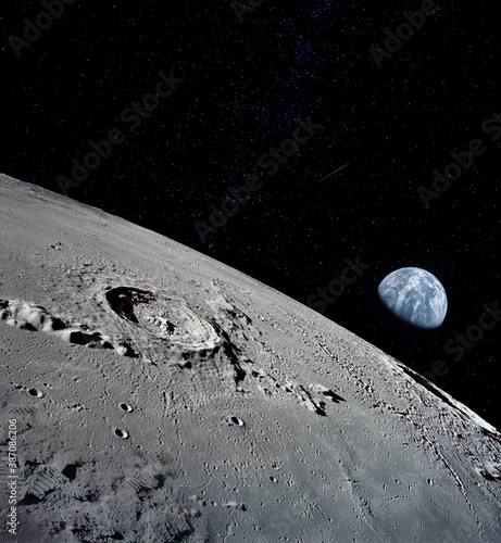 Obraz The lunar surface, taken from a corner, with the preserved footprints of the astronauts who have been there as evidence of the presence of a person. Elements of this image furnished by NASA. - fototapety do salonu
