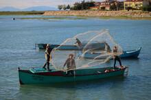 People Fishing With Old Fishin...