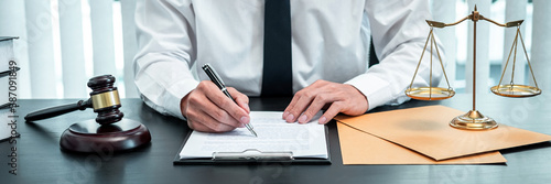 Photo Male lawyer working with legal case document contract in office, law and justice